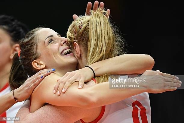 Serbia's Tijana Malesevic celebrates with teammates after scoring during the women's semifinal volleyball match between Serbia and USA at the...
