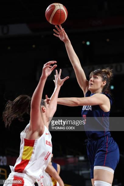 Serbia's Tina Krajisnik shoots the ball as Spain's Raquel Carrera Quintana tries to block in the women's preliminary round group A basketball match...