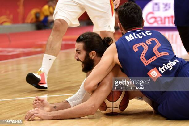 Serbia's Vasilije Micic blocks Spain's Ricky Rubio during the Basketball World Cup Group J second round game between Spain and Serbia in Wuhan on...