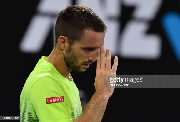 Serbia's Viktor Troicki reacts during their men's singles second round match against Australia's Nick Kyrgios on day three of the Australian Open...