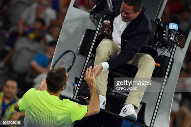Serbia's Viktor Troicki talks to the umpire during their men's singles second round match against Australia's Nick Kyrgios on day three of the...