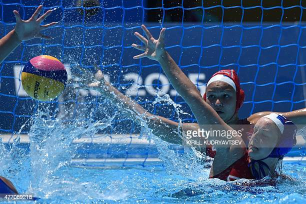 Serbia's Vivien Juhas and Nina Josifovic attempt to block the ball during the women's water polo Group B preliminary round match Italy vs Serbia at...