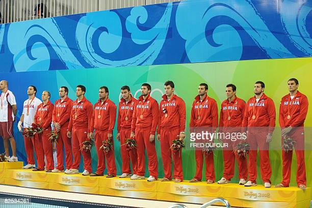 Serbia's water polo players receive their bronze medals after competing in the men's water polo competition at the 2008 Beijing Olympic Games on...