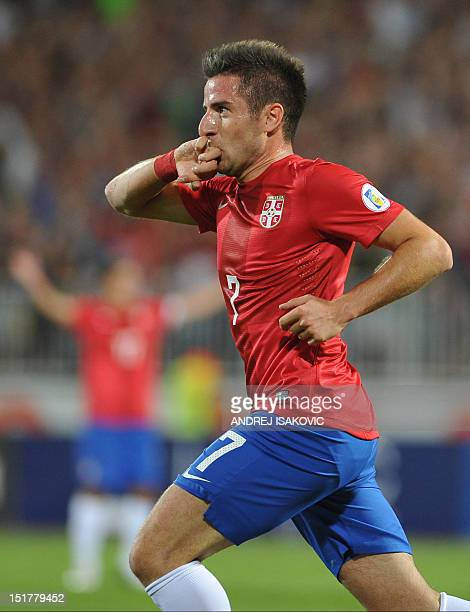 Serbia's Zoran Tosic reacts after scoring a goal during the FIFA 2014 World Cup qualifying football match between Serbia and Wales at the Karadjordje...