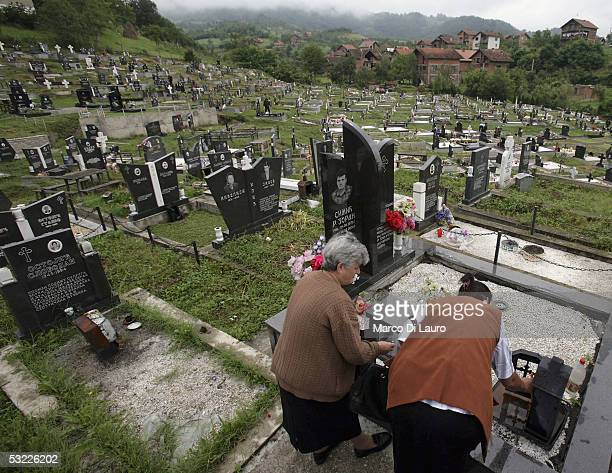 Serbs commemorate their victims who died during the Bosnia war at a graveyard on July 12 2005 in Bratunac 8km from Srebrenica BosniaHerzegovina Serbs...