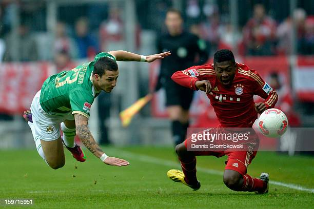 Sercan Sararer of Fuerth and David Alaba of Bayern battle for the ball during the Bundesliga match between FC Bayern Muenchen and SpVgg Greuther...