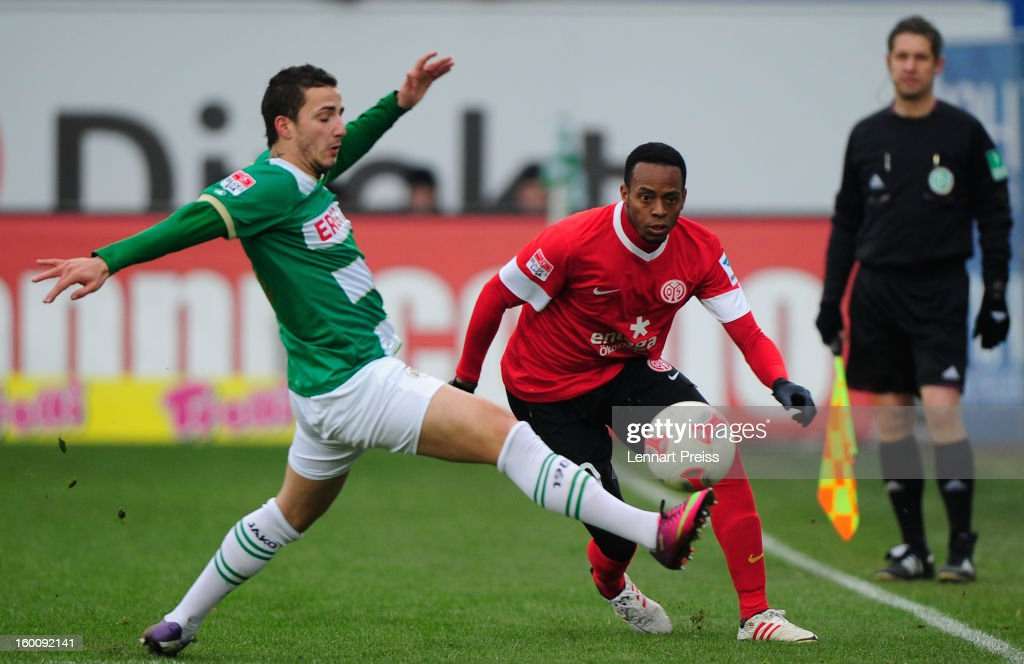 Sercan Sararer (L) of Fuerth challenges Junior Diaz of Mainz during the Bundesliga match between SpVgg Greuther Fuerth and 1. FSV Mainz 05 at Trolli-Arena on January 26, 2013 in Fuerth, Germany.