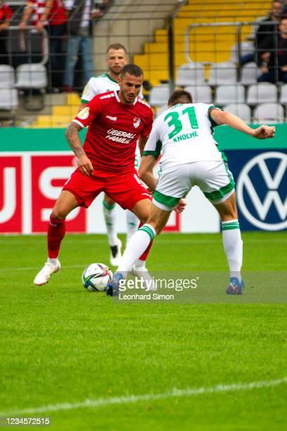 Sercan Sararer of Türkgücü Munich in action against Robin Knoche of Union Berlin in action during the DFB Cup first round match between Türkgücü...