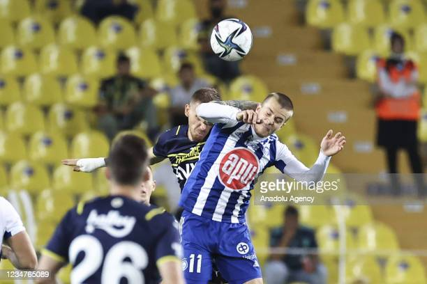 Serdar Aziz of Fenerbahce in action against Roope Riski of HJK Helsinki during UEFA Europa League play-off soccer match between Fenerbahce and HJK...