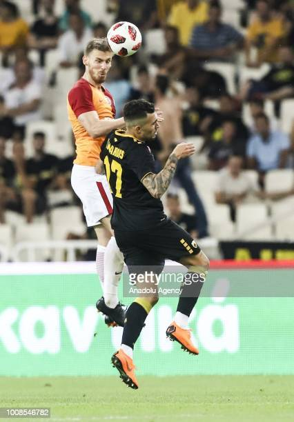 Serdar Aziz of Galatasaray and Victor Klonaridis of AEK Athens vie for the ball during friendly football game between AEK Athens and Galatasaray in...