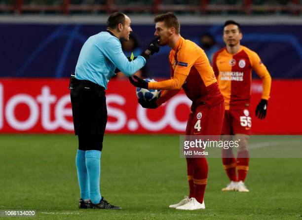 Serdar Aziz of Galatasaray argues with referee Antonio Mateu Lahoz during the Group D match of the UEFA Champions League between FC Lokomotiv Moscow...