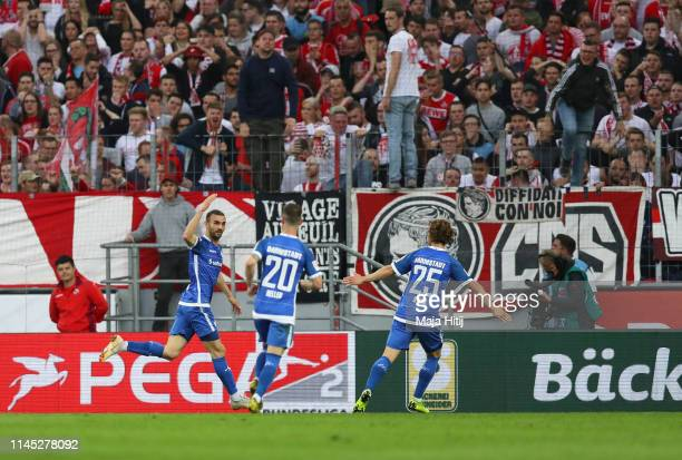 Serdar Dursun of Darmstadt celebrates after scoring his team's first goal with team mates during the Second Bundesliga match between 1. FC Koeln and...