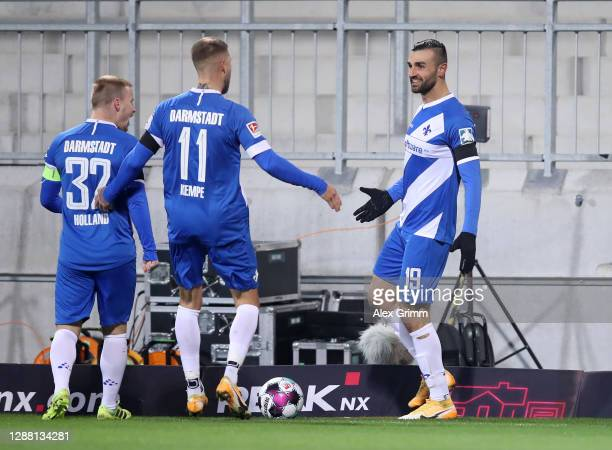 Serdar Dursun of Darmstadt celebrates scoring the second goal with Tobias Kempe and Fabian Holland during the Second Bundesliga match between SV...