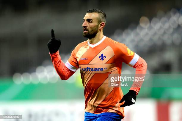 Serdar Dursun of SV Darmstadt 98 celebrates after scoring their side's first goal during the DFB Cup Round of Sixteen match between Holstein Kiel and...