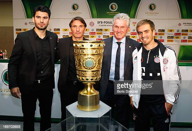 Serdar Tasci and headcoach Bruno Labbadia of VfB Stuttgart and Philipp Lahm and headcoach Jupp Heynckes of FC Bayern Muenchen pose with the cup...