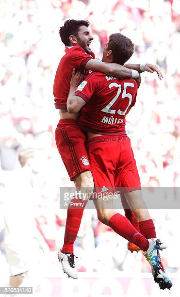 Serdar Tasci of Bayern Munich is congratulated by Thomas Mueller of Bayern Munich after scoring the first goal during the Bundesliga match between FC...