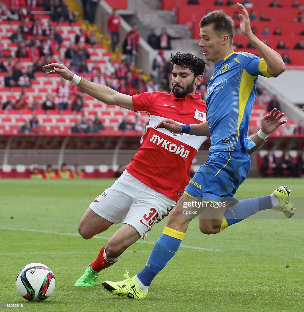 Serdar Tasci of FC Spartak Moscow challenged by Dmitry Poloz of FC Rostov Rostov-on-Don during the Russian Premier League match between FC Spartak Moscow v FC Rostov Rostov on Don at the Arena Otkritie stadium on September 13, 2015 in Moscow, Russia.