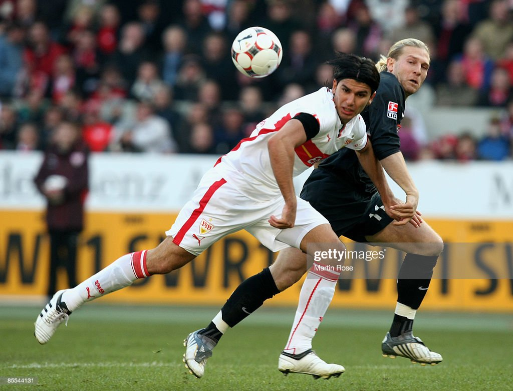 Serdar Tasci (L) of Stuttgart and Andrey Voronin (L) of Berlin battle for the ball during the Bundesliga match between VfB Stuttgart and Hertha BSC Berlin at the Mercedes-Benz Arena on March 21, 2009 in Stuttgart, Germany.