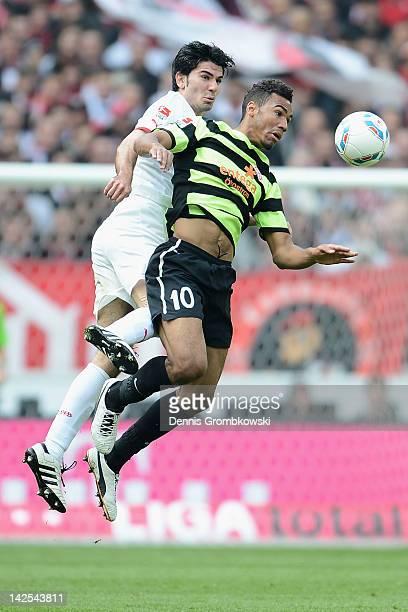 Serdar Tasci of Stuttgart and Eric Maxim ChoupoMoting of Mainz jump for a header during the Bundesliga match between VfB Stuttgart and FSV Mainz 05...