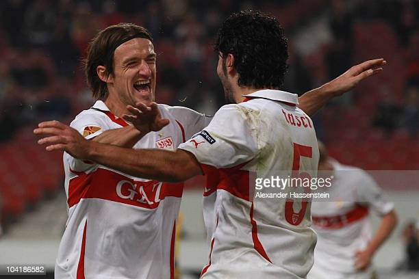 Serdar Tasci of Stuttgart celebrates scoring the third team goal with his team mate Christian Gentner during the UEFA Europa League group H match...