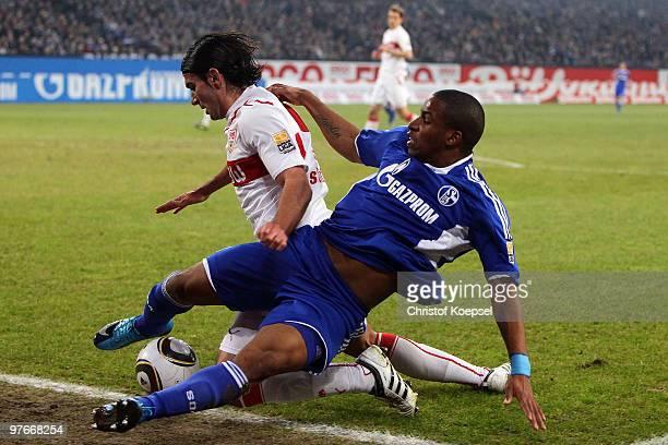 Serdar Tasci of Stuttgart challenges Jefferson Farfan of Schalke during the Bundesliga match between FC Schalke 04 and VfB Stuttgart at the Veltins...