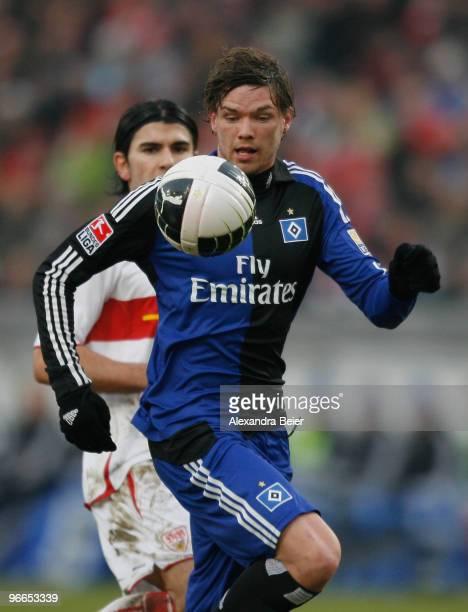 Serdar Tasci of VfB Stuttgart misses to stop Marcus Berg of Hamburger SV from scoring his first goal during the Bundesliga first division soccer...