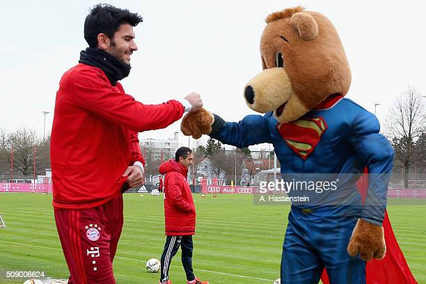 Serdar Tasciof Bayern Muenchen reacts with mascot Bernie dressed as Superman prior to a training session at Bayern Muenchen's training ground...