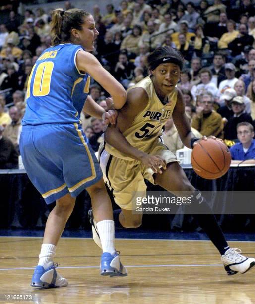 Sereka Wright drives past UCLA's Whitney Jones in Purdue's 5857 win over UCLA December 13 2003