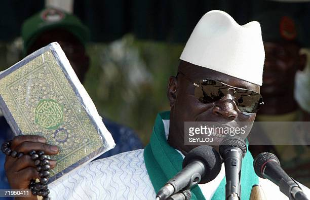Gambia's President and leader of the Alliance for Patriotic Reorientation and Construction party, Yahya Jammeh, holds the Koran during a presidential...