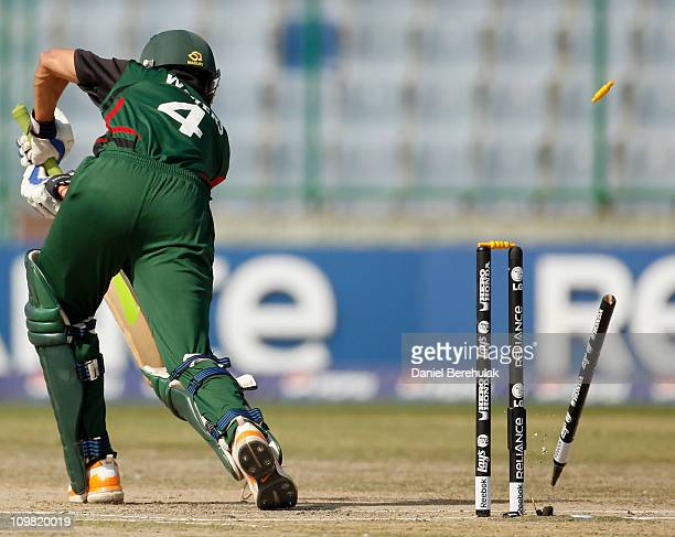 Seren Waters of Kenya is bowled by Henry Osinde of Canada during the ICC Cricket World Cup group A match between Canada and Kenya at Feroz Shah Kotla...