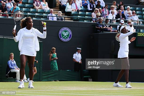 Serena and Venus Williams of the United States during the warm up before their Ladies Doubles second round match against Kristina Barrois of Germany...