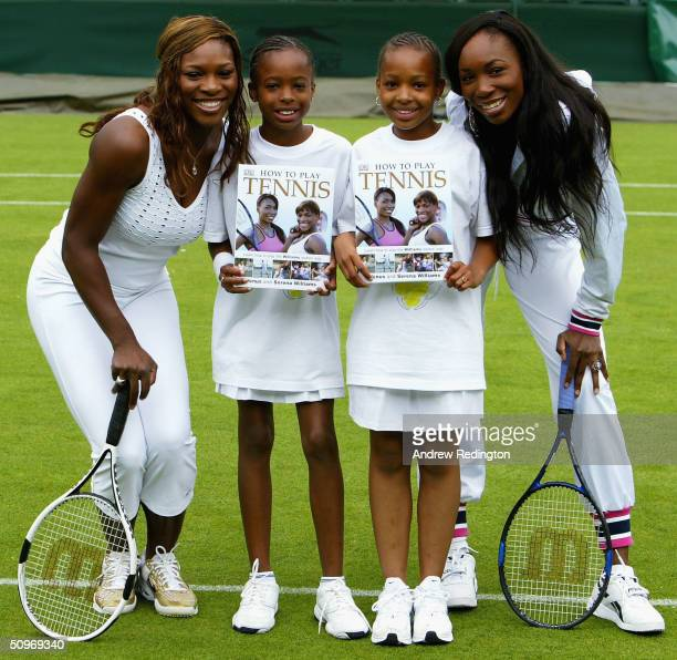 "Serena and Venus Williams of the United States pose with two junior players during a photocall to promote their book ""How To Play Tennis"" and the..."