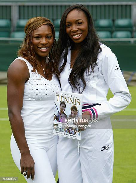 Serena and Venus Williams of the United States pose with two junior players during a photocall to promote their book How To Play Tennis and the...