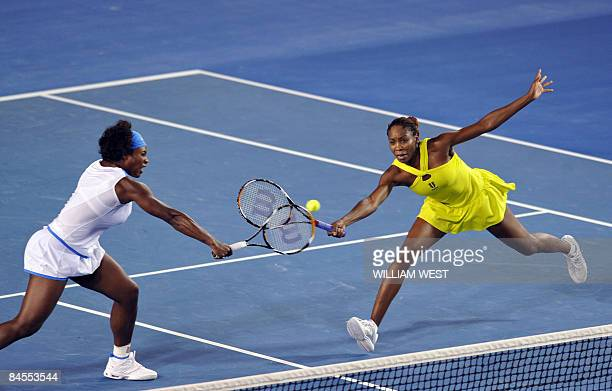 Serena and Venus Williams of the US in action during their women's doubles final match against Ai Sugiyama of Japan and Daniela Hantuchova of...
