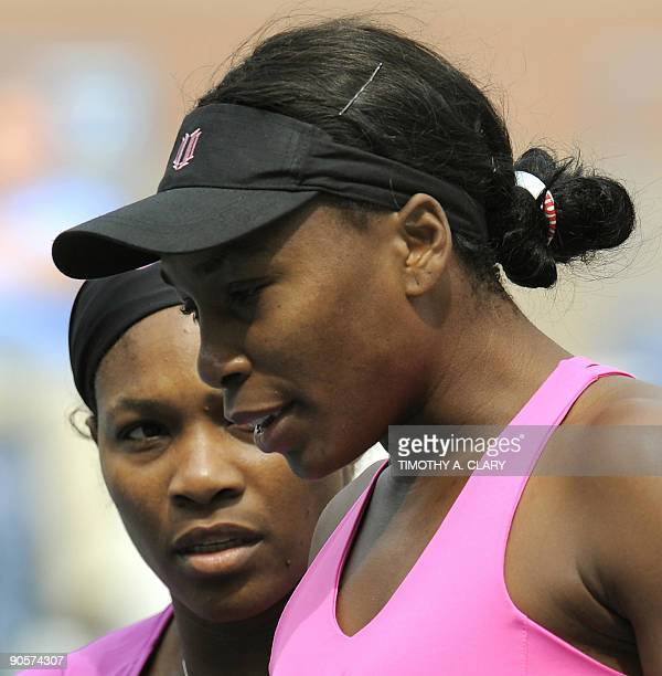 Serena and Venus Williams of the US play against Alisa Kleybanova and Ekaterina Makarova of Russia during their Women's Doubles Semifinals US Open...