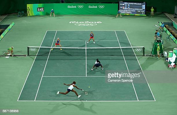 Serena and Venus Williams of the USA in action against Lucie Safarova and Barbora Strycova of the Czech Republic in their doubles match on Day 2 of...