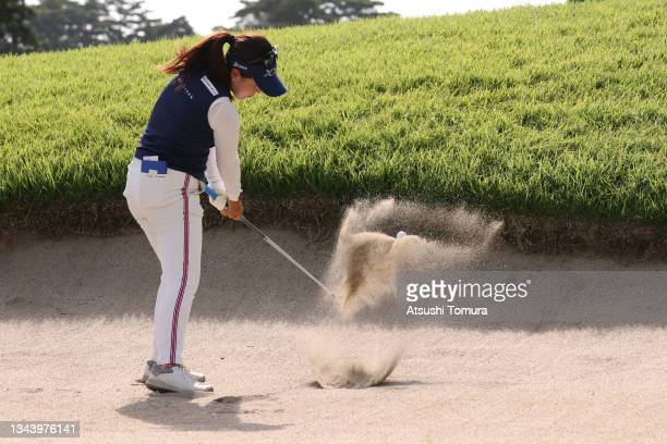 Serena Aoki of Japan hits out from a bunker on the 13th hole during the first round of the 54th Japan Women's Open Golf Championship at Karasuyamajo...