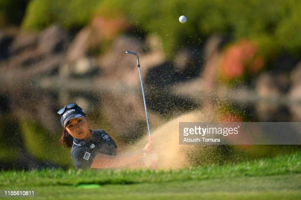 Serena Aoki of Japan hits out from a bunker on the 18th hole during the first round of the Ai Miyazato Suntory Ladies Open Golf Tournament at Rokko...