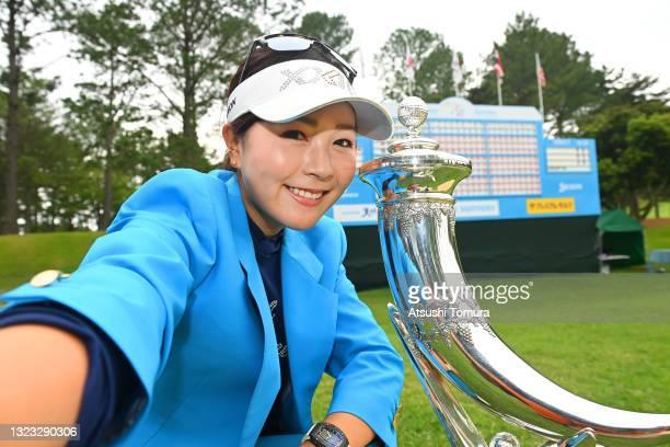 Serena Aoki of Japan imitates the selfie after winning the tournament follwoing the final round of the Ai Miyazato Suntory Ladies Open at Rokko...