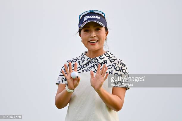 Serena Aoki of Japan poses for photographs after holing out on the 9th green during the first round of the JLPGA Championship Konica Minolta Cup at...