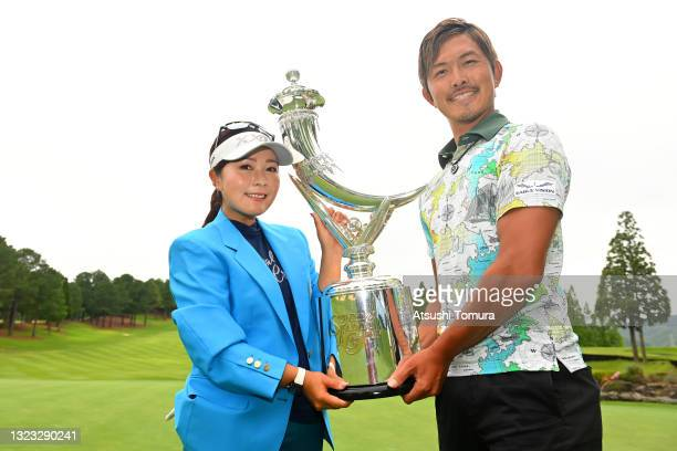 Serena Aoki of Japan poses with her caddie Shota Onishi after winning the tournament following the final round of the Ai Miyazato Suntory Ladies Open...