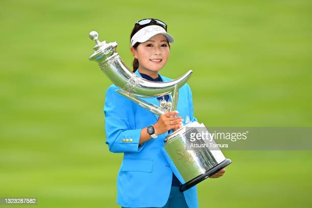 Serena Aoki of Japan poses with the trophy after winning the tournament following the final round of the Ai Miyazato Suntory Ladies Open at Rokko...