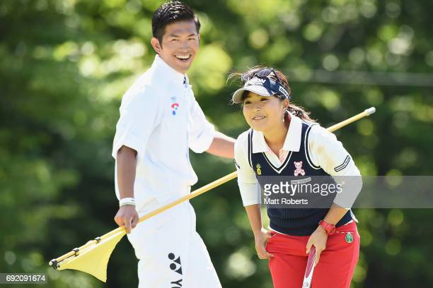 Serena Aoki of Japan shares a laugh with her caddie on the 17th green during the final round of the Yonex Ladies Golf Tournament 2016 at the Yonex...
