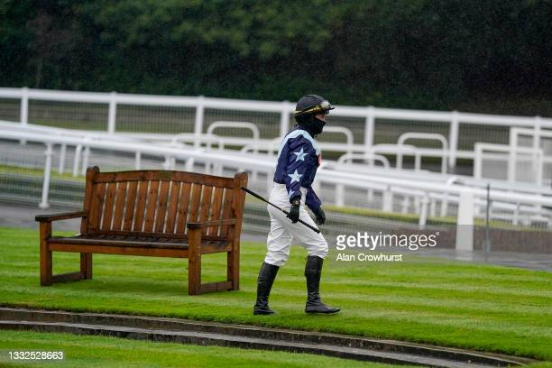 Serena Brotherton makes her way to the parade ring before riding the first winner of the evening at Sandown Park on August 05, 2021 in Esher, England.