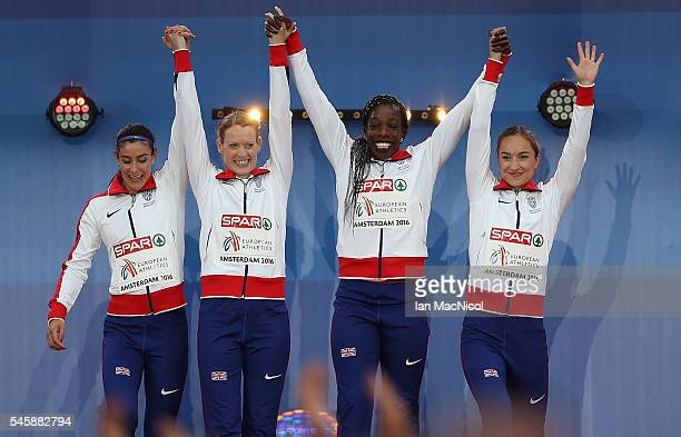 Serena Bundy Davies Eilidh Doyle Anyika Onuora and Emily Diamond of Great Britan celebrate on the podium after winning gold in the final of the...