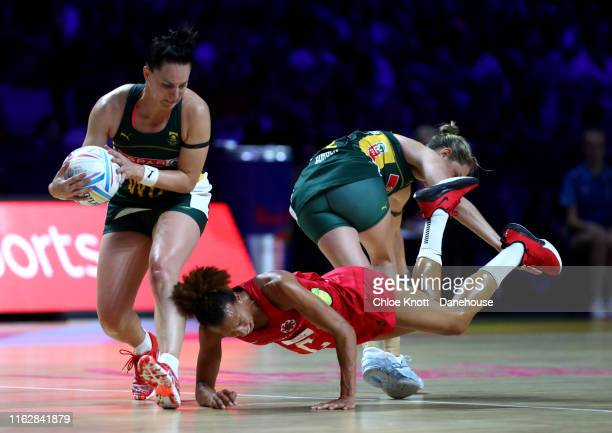 Serena Guthrie of England and Shadine Van De Merwe and Bongiwe Msomi of South Africa in action during the preliminaries stage two schedule match...