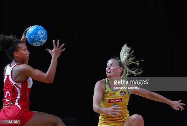 Serena Guthrie of England takes the ball down the court as Kim Green of Australia defends during game three of the International Test series between...
