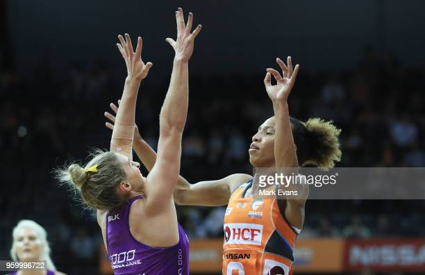 Serena Guthrie of the Giants competes with Gabi Simpson of the Firebirds during the round four Super Netball match between the Giants and the...
