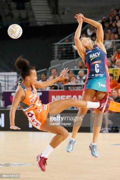 Serena Guthrie of the Giants falls as Kate Moloney of the Vixens misses the pass during the Super Netball Preliminary Final match between the Vixens...