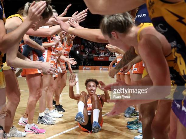 Serena Guthrie of the Giants rolls through a guard of honour after announing her retirement during the Super Netball Preliminary Final match between...